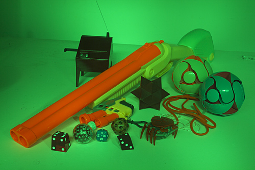 Green-lit assemblage of objects