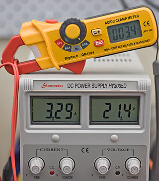 Disagreement between clamp-meter and power-supply