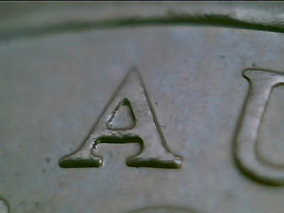Five cent piece close-up - angled